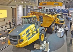 The dump body of the Bell B60 has a similar configuration to that of a rigid truck